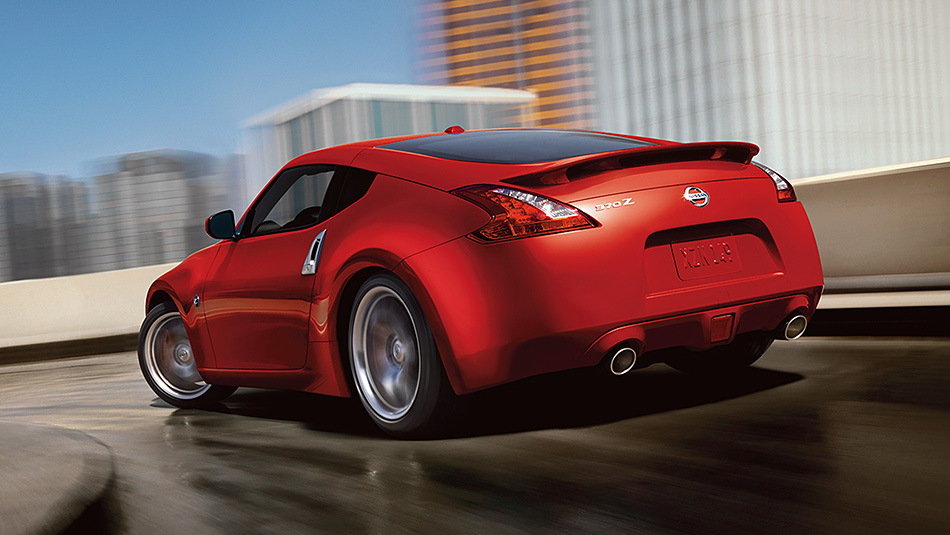 2016-370z-coupe-touring-sport-solid-red-back-view-highway-driving-Onramp